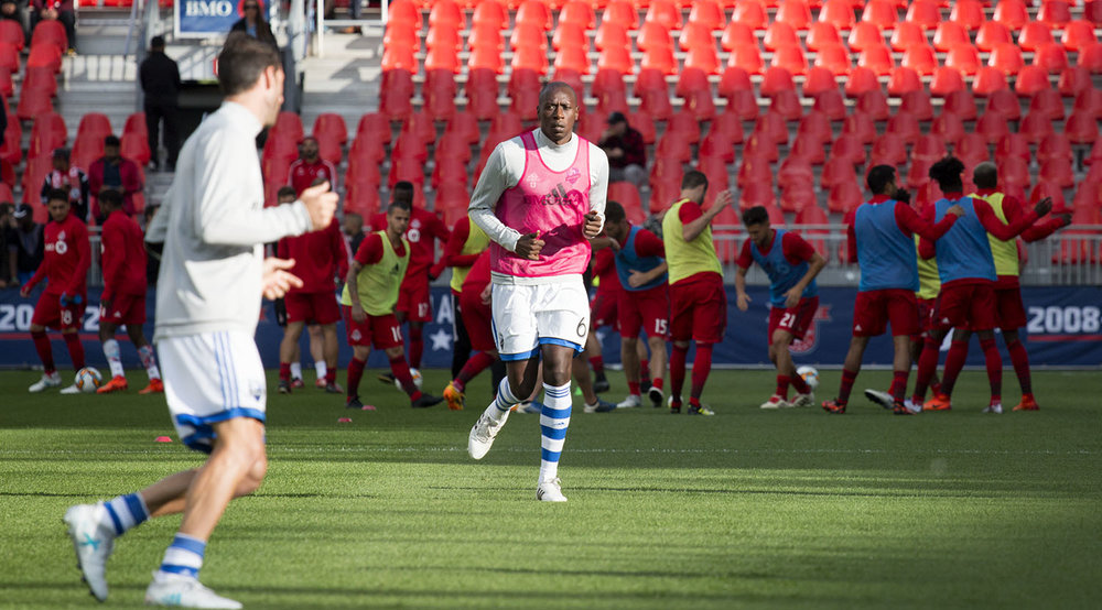 Hassoun Camara of the Montreal Impact does his warm ups in front of a Toronto FC squad warming up before the Canadian Championship in 2017. Image by Dennis Marciniak of denMAR Media.