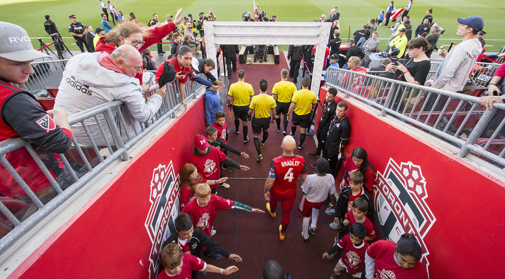 Michael Bradley comes out of the tunnel greeted by fans during the Canadian Championship in 2017. Image by Dennis Marciniak of denMAR Media.
