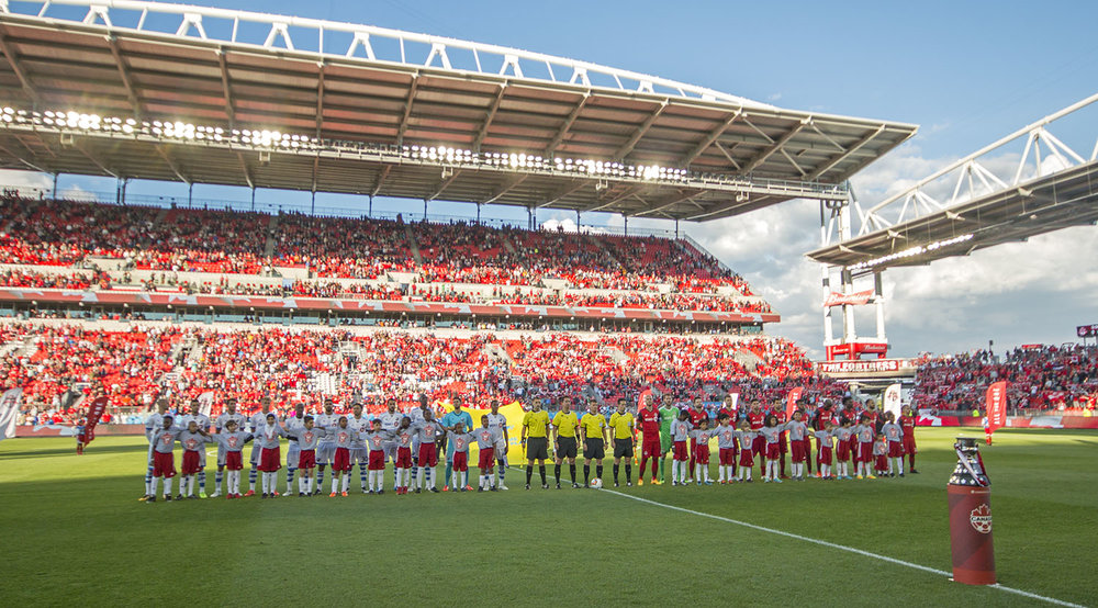 The national anthem being played with the Voyageurs Cup in the foreground in 2017 at BMO Field. Image by Dennis Marciniak of denMAR Media.