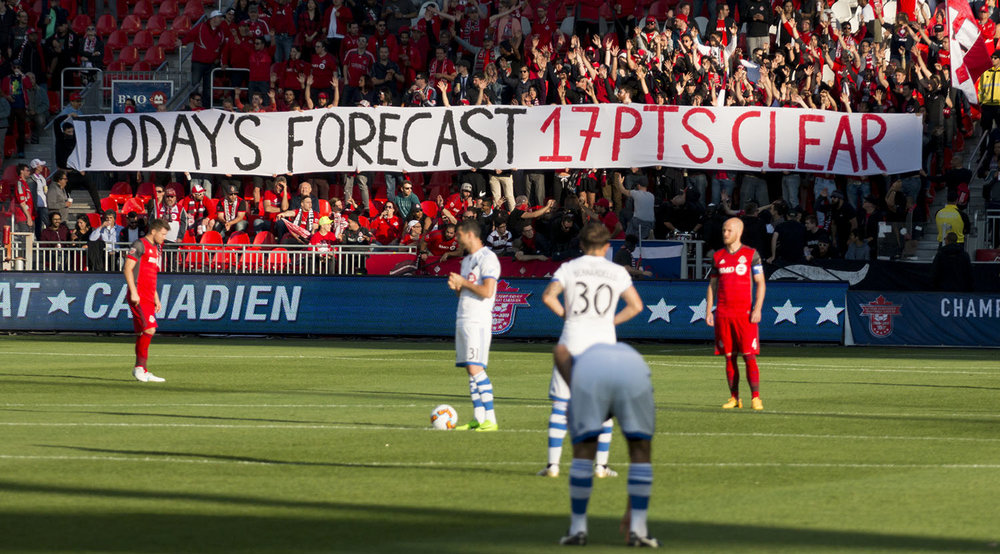 Today's forecast 17 pts. clear reads the banner unraveled by the south end supporter's section in reference to the amount of points Toronto FC are ahead the Montreal Impact in the MLS regular season table. Image by Dennis Marciniak of denMAR Media.