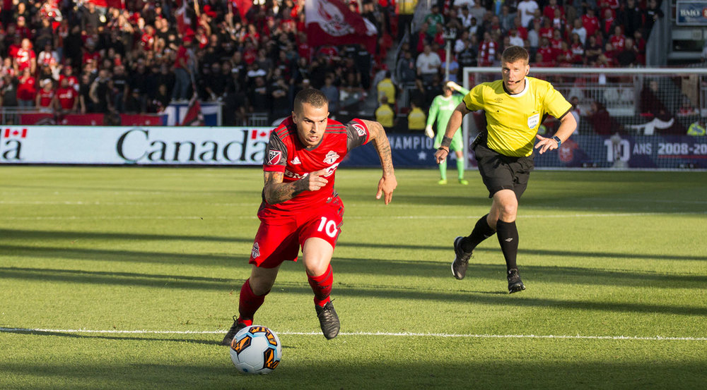 Sebastian Giovinco drives the ball down the field with brilliant pace during the Canadian Championship finale in 2017. Image by Dennis Marciniak of denMAR Media.