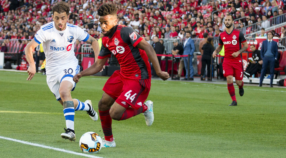 Raheem Edwards takes the ball past a Montreal Impact defender at the Canadian Championship finale in 2017. Image by Dennis Marciniak of denMAR Media.