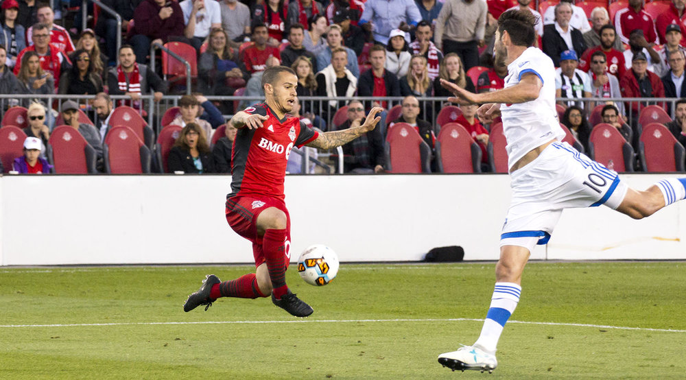 Giovinco and Ignacio Piatti in the air as both teams struggle to find a second goal. Image by Dennis Marciniak of denMAR Media.