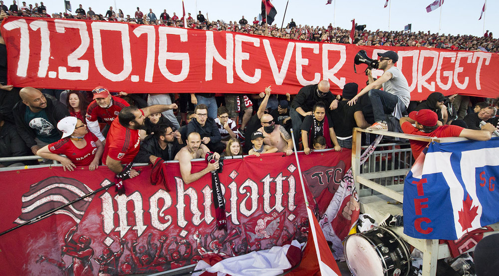 11.30.16 Never Forget a banner in reference to the 2016 MLS Cup semi final shown during the 2017 Canadian Championship by inebriatti and south end supporters. Image by Dennis Marciniak of denMAR Media.