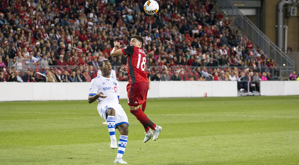 Marky Delgado goes for a head before an Montreal Impact player can get to it. Image by Dennis Marciniak of denMAR Media.