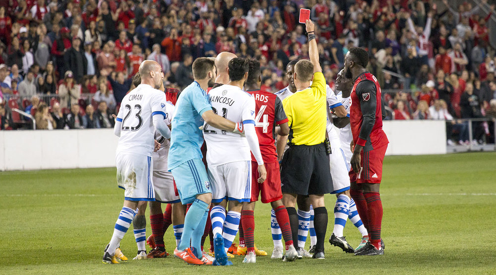 The first official issuing a red card to a Montreal Impact player in the second half of the second leg of the Canadian Championship Final. Image by Dennis Marciniak of denMAR Media.