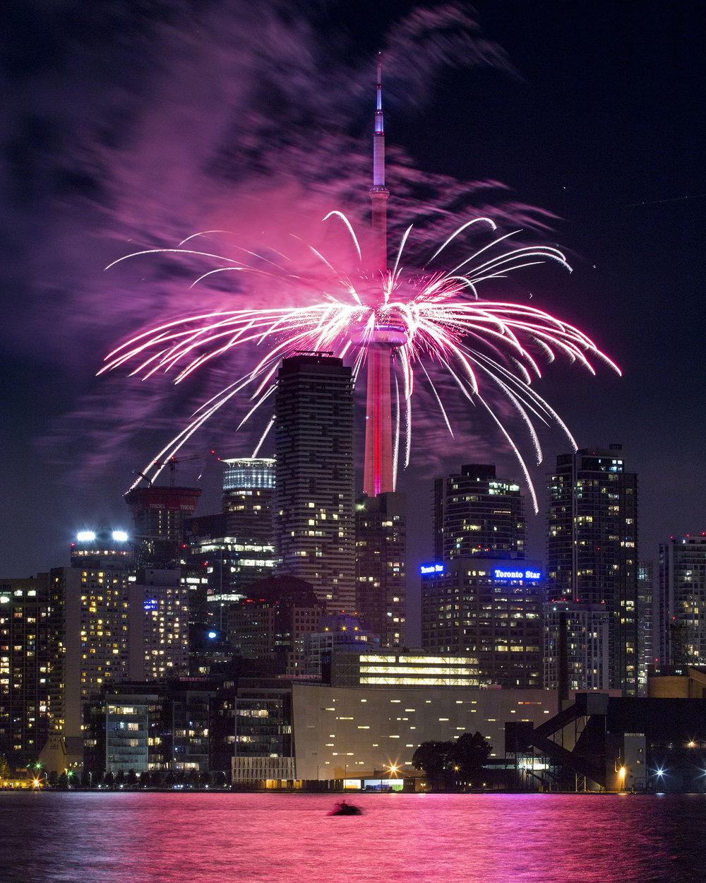 Fireworks shooting off the CN Tower for Canada Day 150 Celebrations in Toronto, Ontario. Image by Dennis Marciniak of denMAR Media.