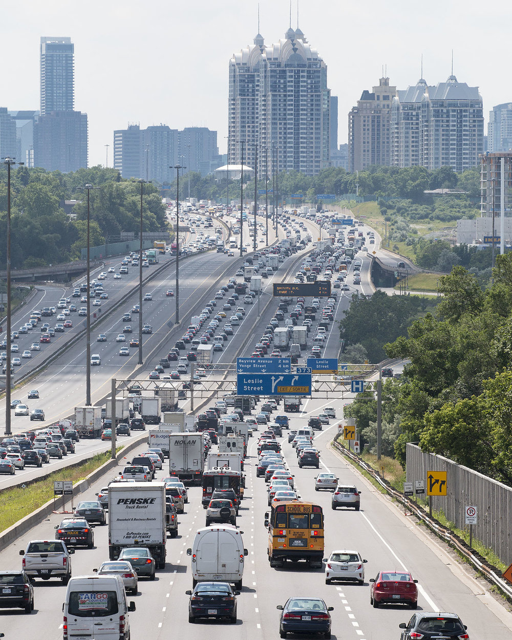 Traffic on Highway 401 going Eastbound during a typical weekday rush hour period in the heat of the summer. Image by Dennis Marciniak of denMAR Media.