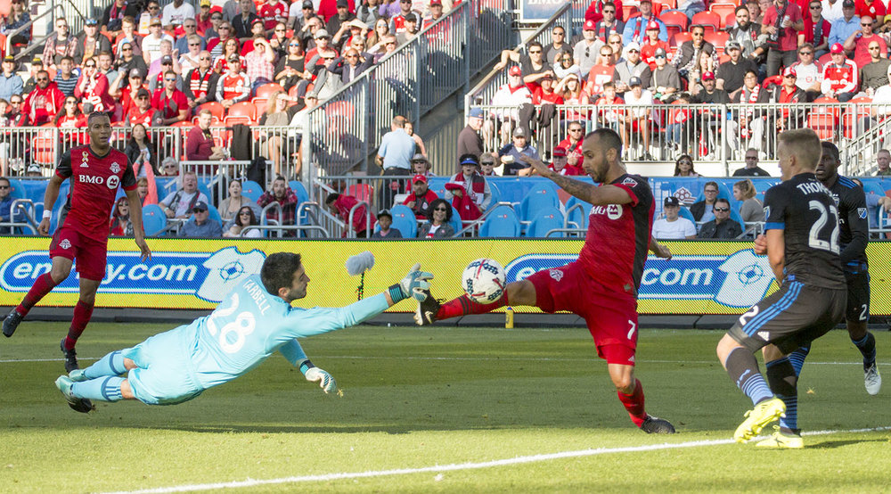 Víctor Vázquez gets it past the goalkeeper for the first goal of the day against the San Jose Earthquakes. Image by Dennis Marciniak of denMAR Media.