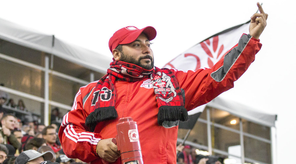 A south end capo giving the finger to the first official Chris Penso for disaterous offciating during the first half of the TFC v NYRB match at BMO Field in 2017. Image by Dennis Marciniak of denMAR Media.