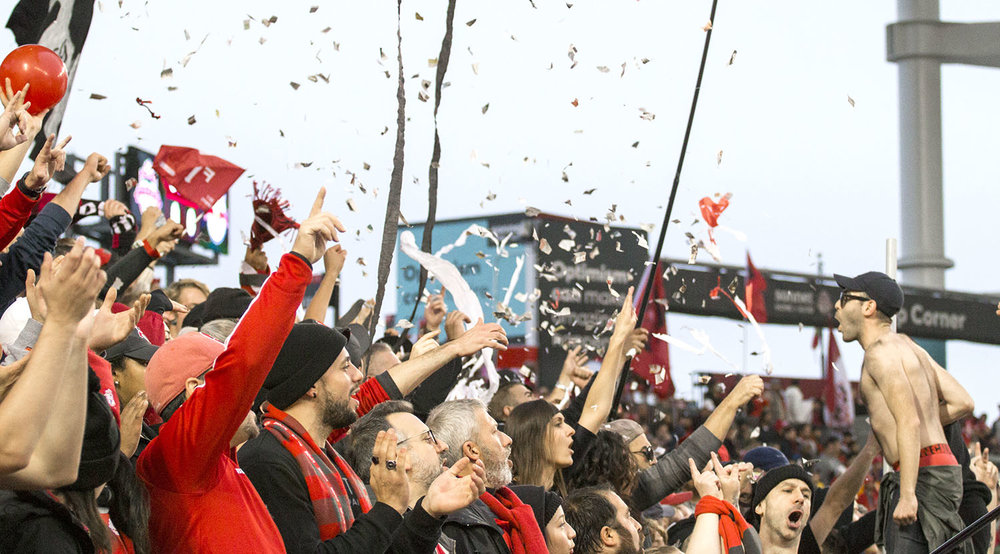 The south end supporter's section throwing confetti into the air. Image by Dennis Marciniak of denMAR Media.