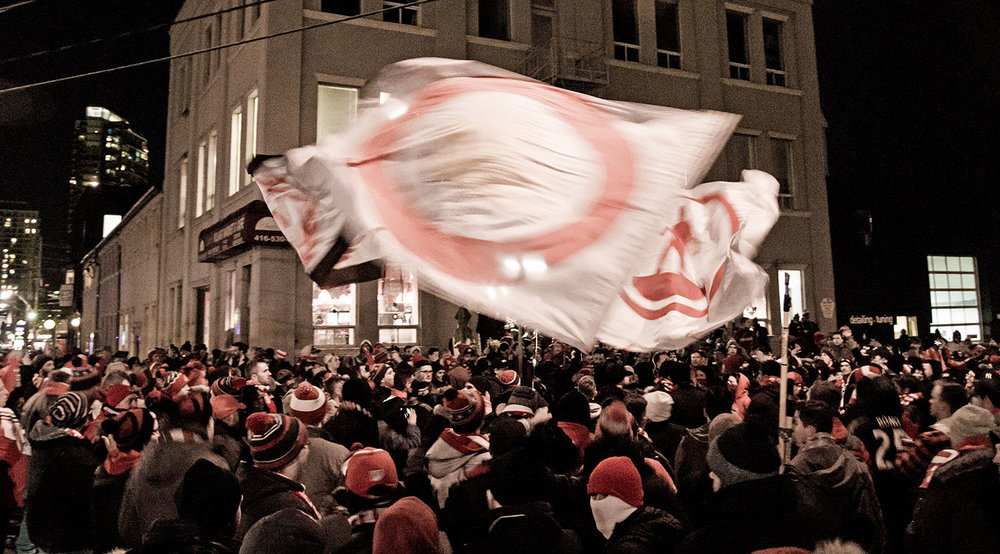 Toronto FC supporters gather in Liberty Village before the Eastern Conference Final match in 2017. Image by Dennis Marciniak of denMAR Media.