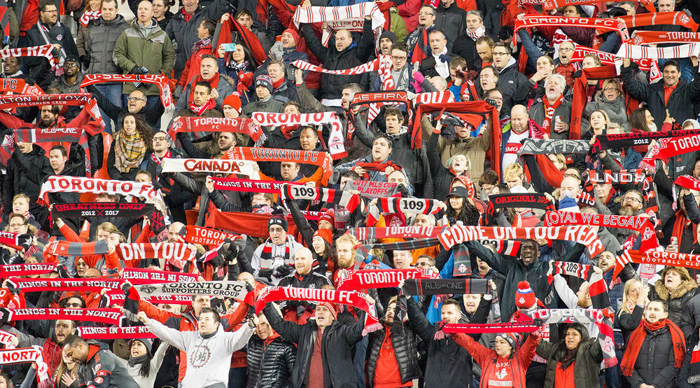 Toronto FC supporters in the south end of BMO Field raise the scarves up high during the national anthem on November 29, 2017.  Image by Dennis Marciniak of denMAR Media.