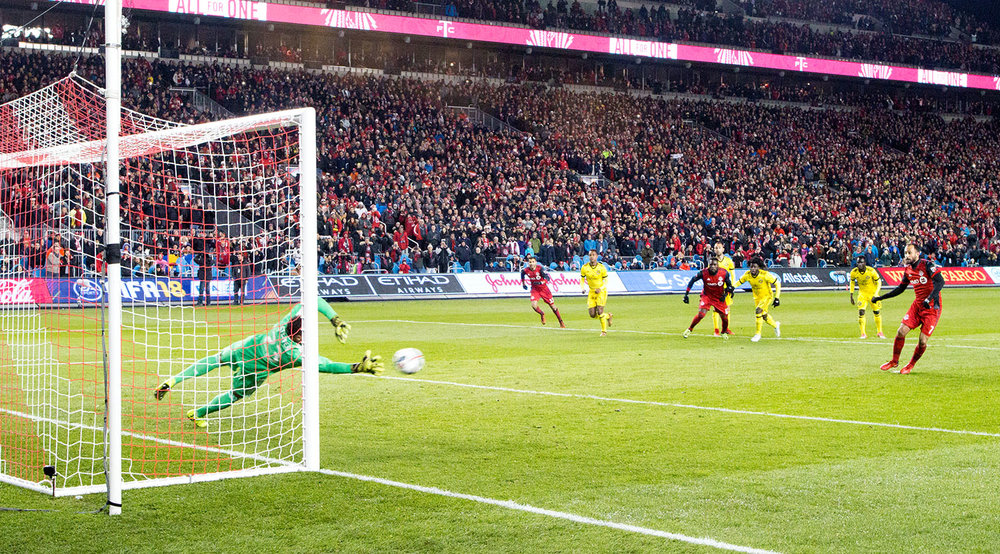 Victor Vazquez takes a penalty kick that is saved by Columbus Crew's goalkeeper Zack Steffen during the 2017 MLS Eastern Conference Final at BMO Field.  Image by Dennis Marciniak of denMAR Media.