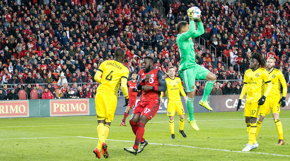 Columbus Crew goalkeeper Zack Steffen collects the ball out of the 18 yard box.  Image by Dennis Marciniak of denMAR Media.