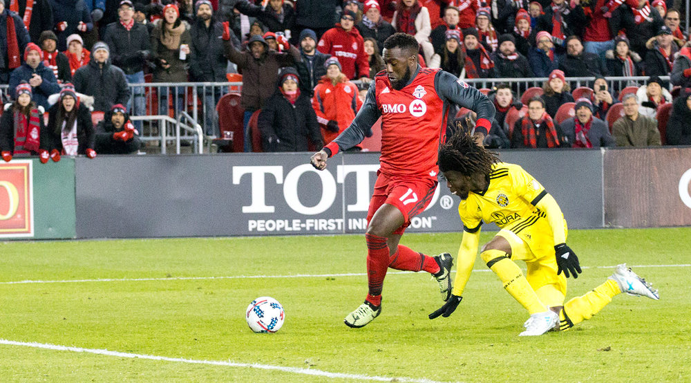 Jozy Altidore about to kick the ball into the back of the net scoring the series deciding goal at BMO Field during the 2017 Major League Soccer playoffs.  Image by Dennis Marciniak of denMAR Media.