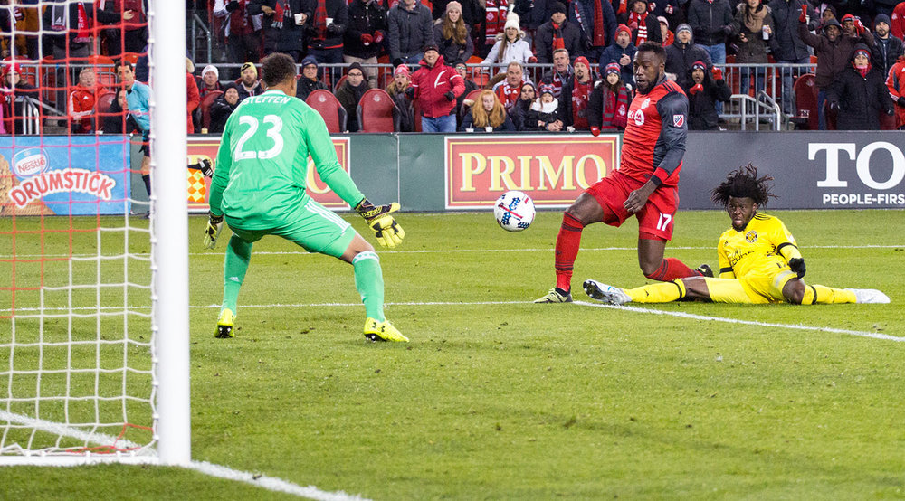 Jozy Altidore scoring the game winning goal for Toronto FC during the 2017 Eastern Conference Playoffs.  Image by Dennis Marciniak of denMAR Media.