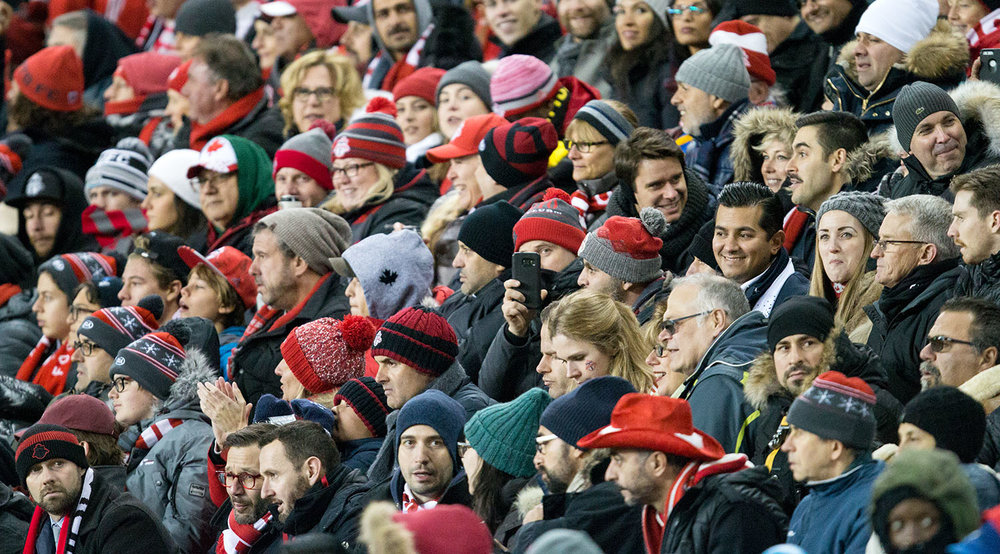 Toronto FC supporters look on in the stands as play continues in the second half of the Eastern Conference Final at BMO Field in 2017.  Image by Dennis Marciniak of denMAR Media.