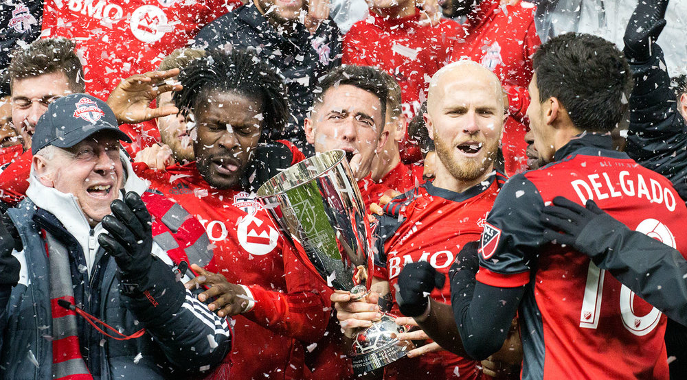Toronto FC celebrating the advance to the 2017 Major League Soccer Finale with the Eastern Conference trophy.  Image by Dennis Marciniak of denMAR Media.