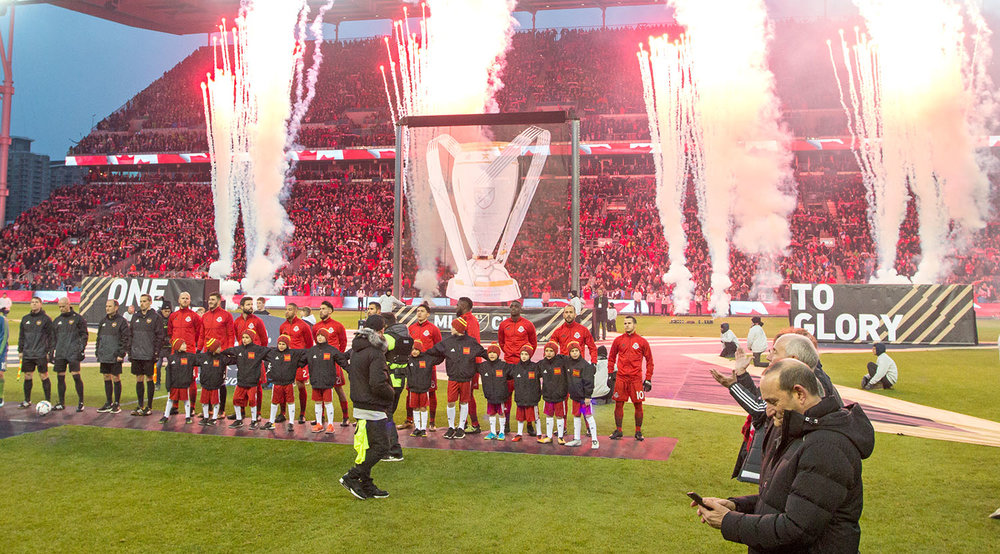 Toronto FC with Don Garber in the foreground as fireworks go off in the background during the opening ceremonies for the 2017 MLS Cup Final. Image by Dennis Marciniak of denMAR Media.