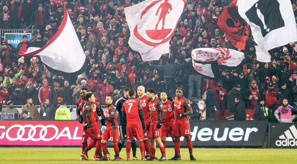 Toronto FC's starting XI breaking away seconds away from kickoff during the 2017 MLS Cup playoffs against Seattle. Image by Dennis Marciniak of denMAR Media.