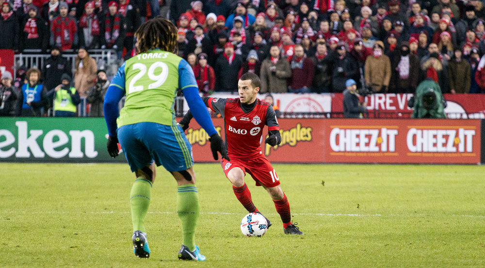 Sebastian Giovinco tries to find space with Roman Torres trying to shut down the play during the 2017 MLS Cup Final. Image by Dennis Marciniak of denMAR Media.