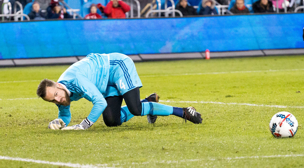 Stefan Frei (former Toronto FC goalkeeper) watching the ball clear his box after a save during the 2017 Major League Soccer Cup Final at BMO Field. Image by Dennis Marciniak of denMAR Media.