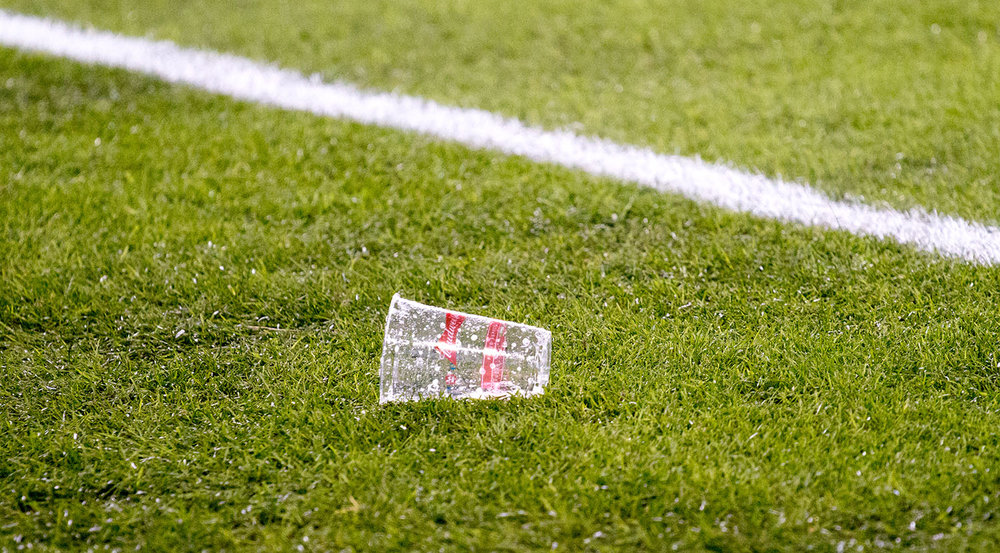 A beer thrown onto the pitch at BMO Field during the Major League Soccer Cup Final. Image by Dennis Marciniak of denMAR Media.