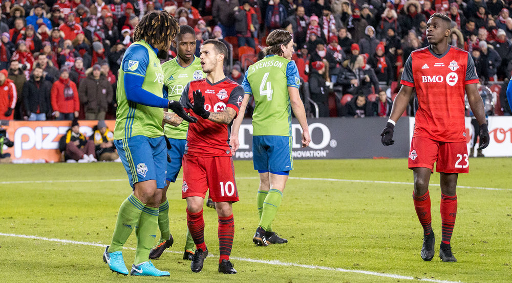 Sebastian GIovinco and Seattle Sounders' Roman Torres get into it during the second half of the MLS Cup Final on December 9, 2017. Image by Dennis Marciniak of denMAR Media.