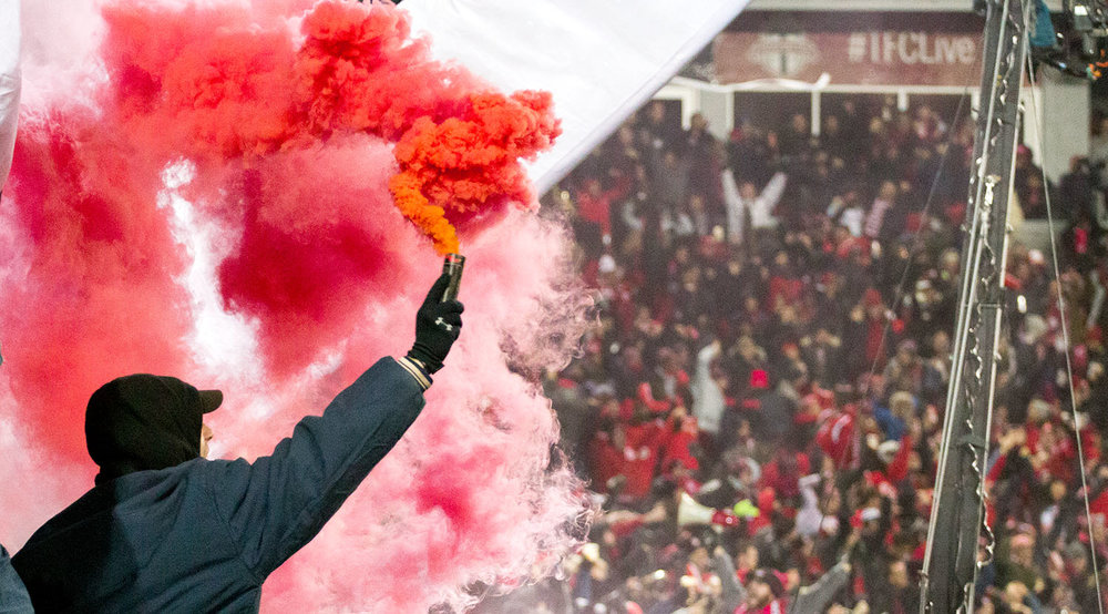 South End Supporter Groups light smoke up in celebration of the Jozy Altidore goal during the 2017 MLS Cup Playoffs at BMO Field in Toronto, Canada. Image by Dennis Marciniak of denMAR Media.