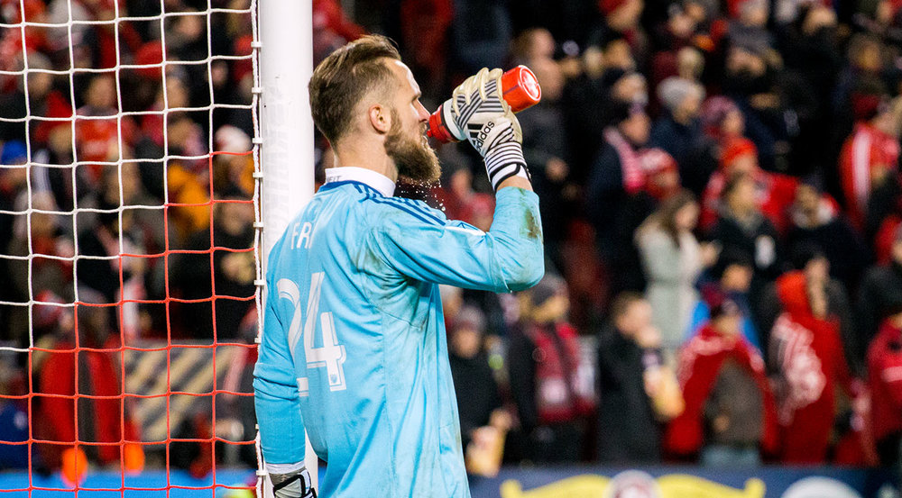 Stefan Frei takes a sip of water as it trickles through his beard during the 2017 MLS Cup playoffs at BMO Field. Image by Dennis Marciniak of denMAR Media.