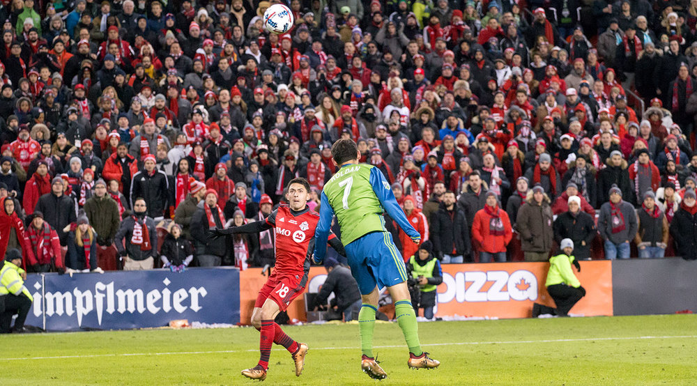 Marky Delgado awaits the landing of the ball in the attacking end during the MLS Cup playoffs in 2017. Image by Dennis Marciniak of denMAR Media.
