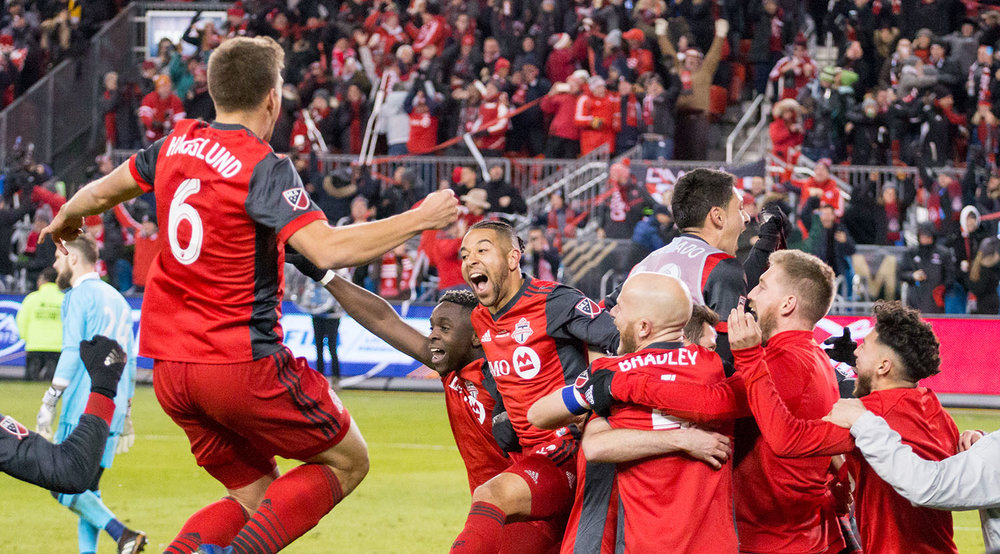 Toronto FC celebrating moments after the second goal is scored for Toronto FC solidying the 2017 MLS Cup victory for the team. Image by Dennis Marciniak of denMAR Media.