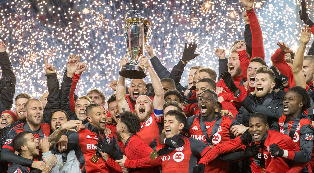 Sparks fly as the MLS Cup is finally lifted at BMO Field in 2017 after 11 seasons. Image by Dennis Marciniak of denMAR Media.