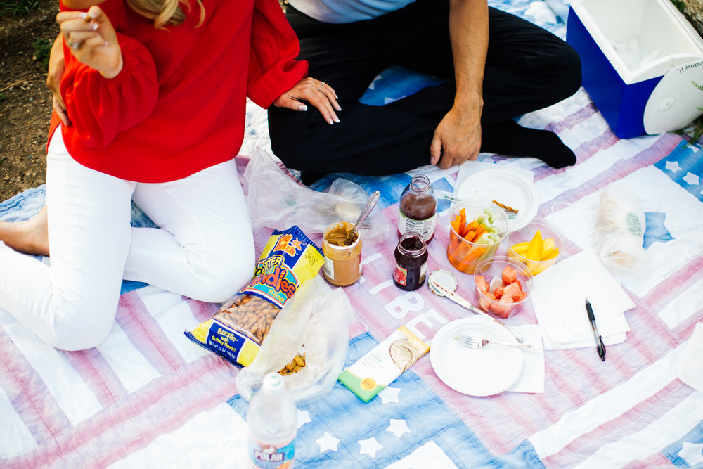 cute couple having a picnic for their romantic minneapolis engagement session