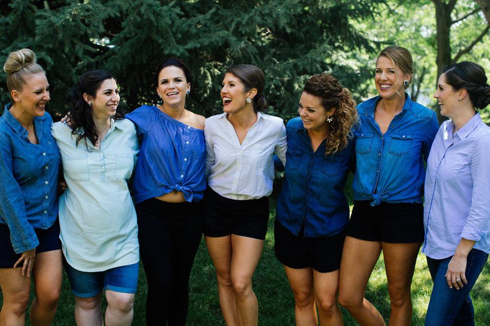 Bridesmaids wearing denim blue button downs