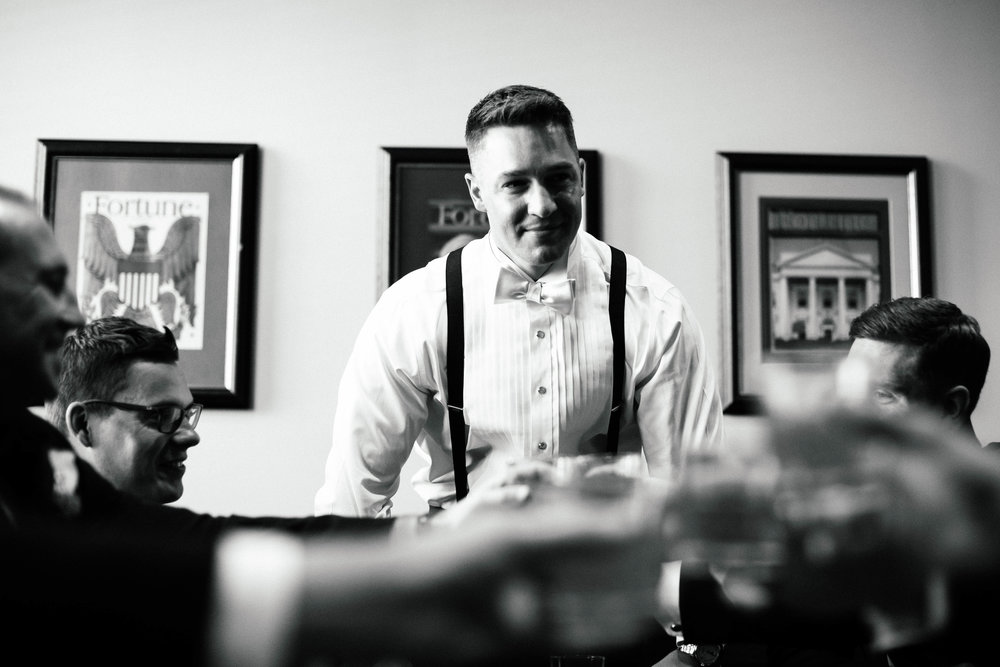 Photography of groomsmen getting ready