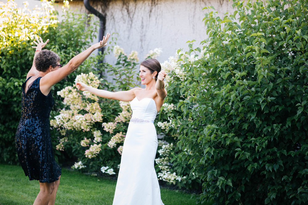 Wedding day excitement captured by Minneapolis Wedding Photographer Rick Gmitro