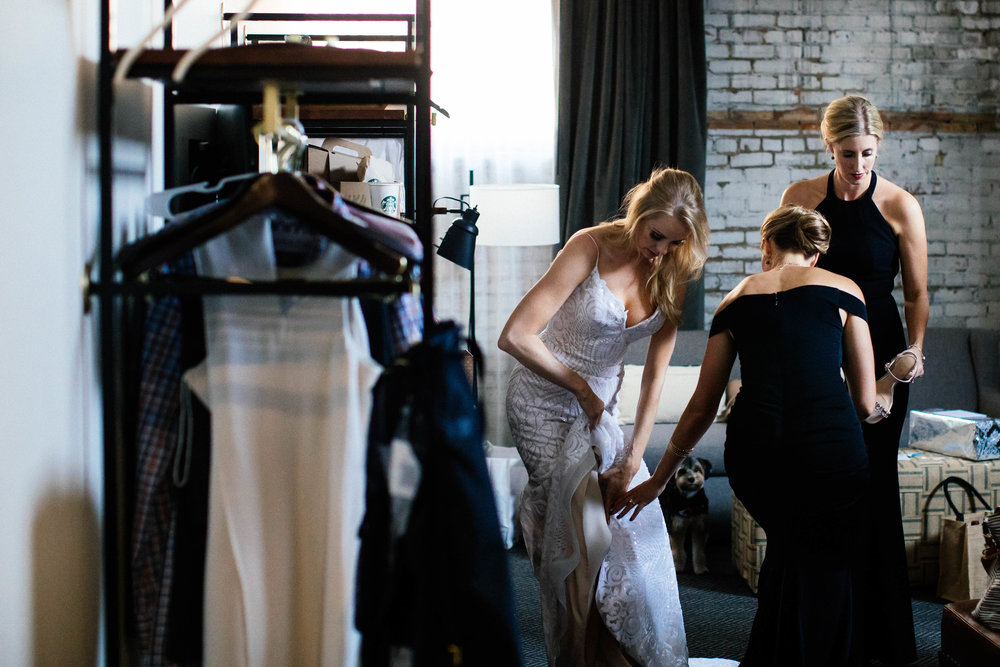 Hewing Hotel Wedding Photography Bridesmaids helping bride get ready