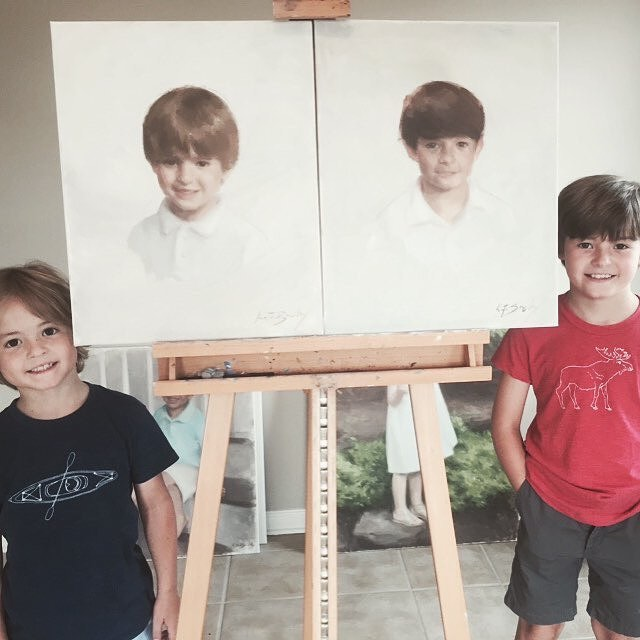 Noah and Eli with their portraits