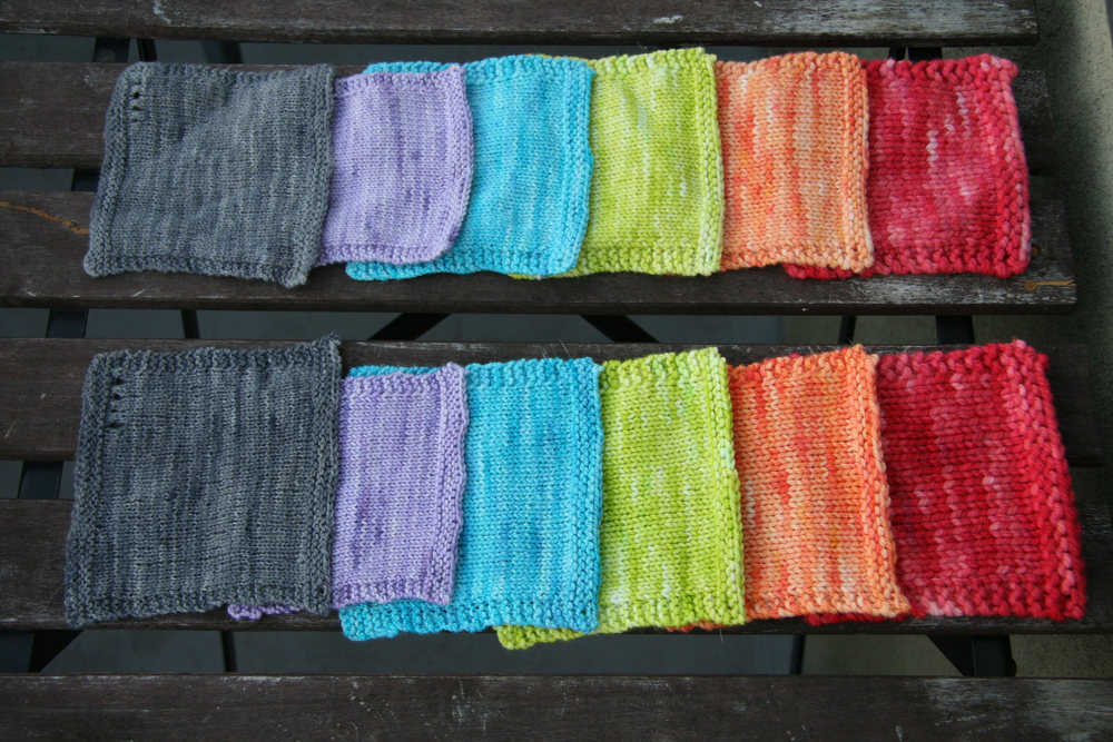 From left to right: Lace in Zoot Soot Riot (grey); Sock in Lavish Lavender (purple); Sport in Tumbling Turquoise (blue); DK in Dill With It (green); Worsted in Melon-Choly (orange); Bulky in Hibiscus Kiss (red). Top row of swatches machine washed; bottom row hand washed.