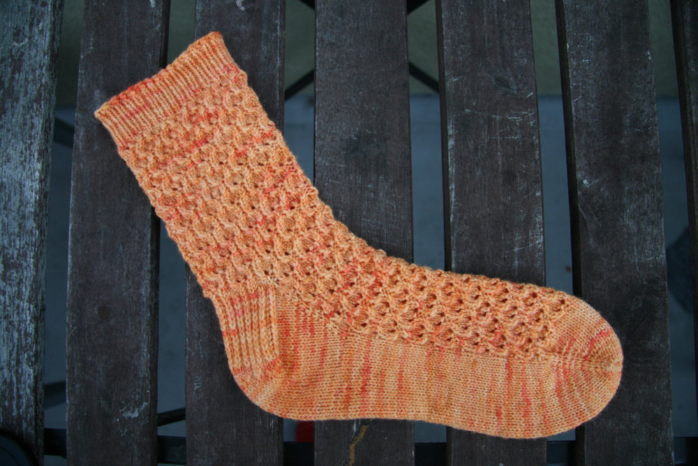 "Faraday by Helena Bristow, knit in Oink Pigments Sport, ""Melon-choly"""