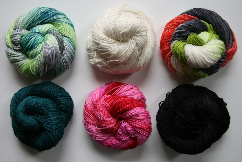 Oink Sock in our 6 new colors, clockwise from top left: 4 Play; Birthday Suit; Don't Be Koi; The Dark Knitnight; Stupid Cupid; That's A Moray
