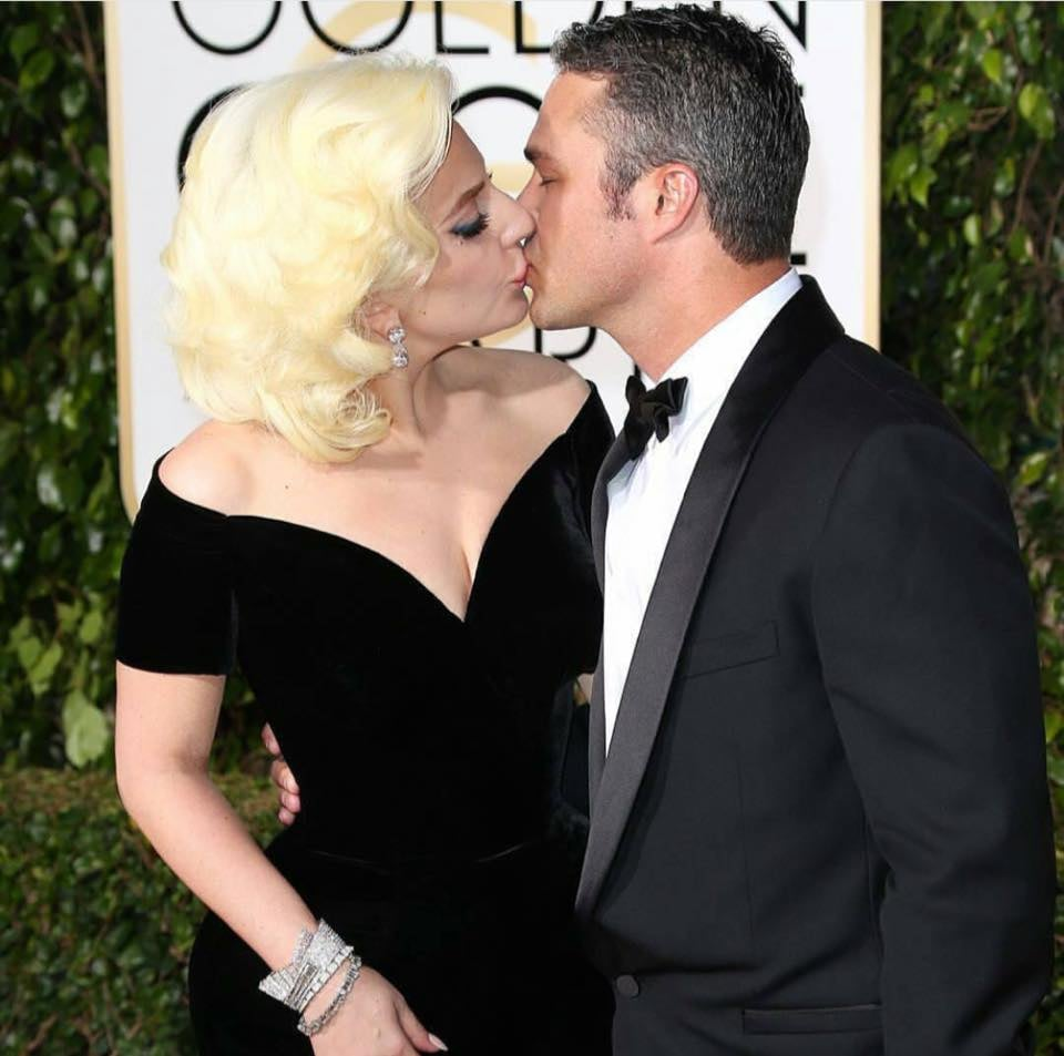 Lady Gaga and Taylor Kinney share a kiss