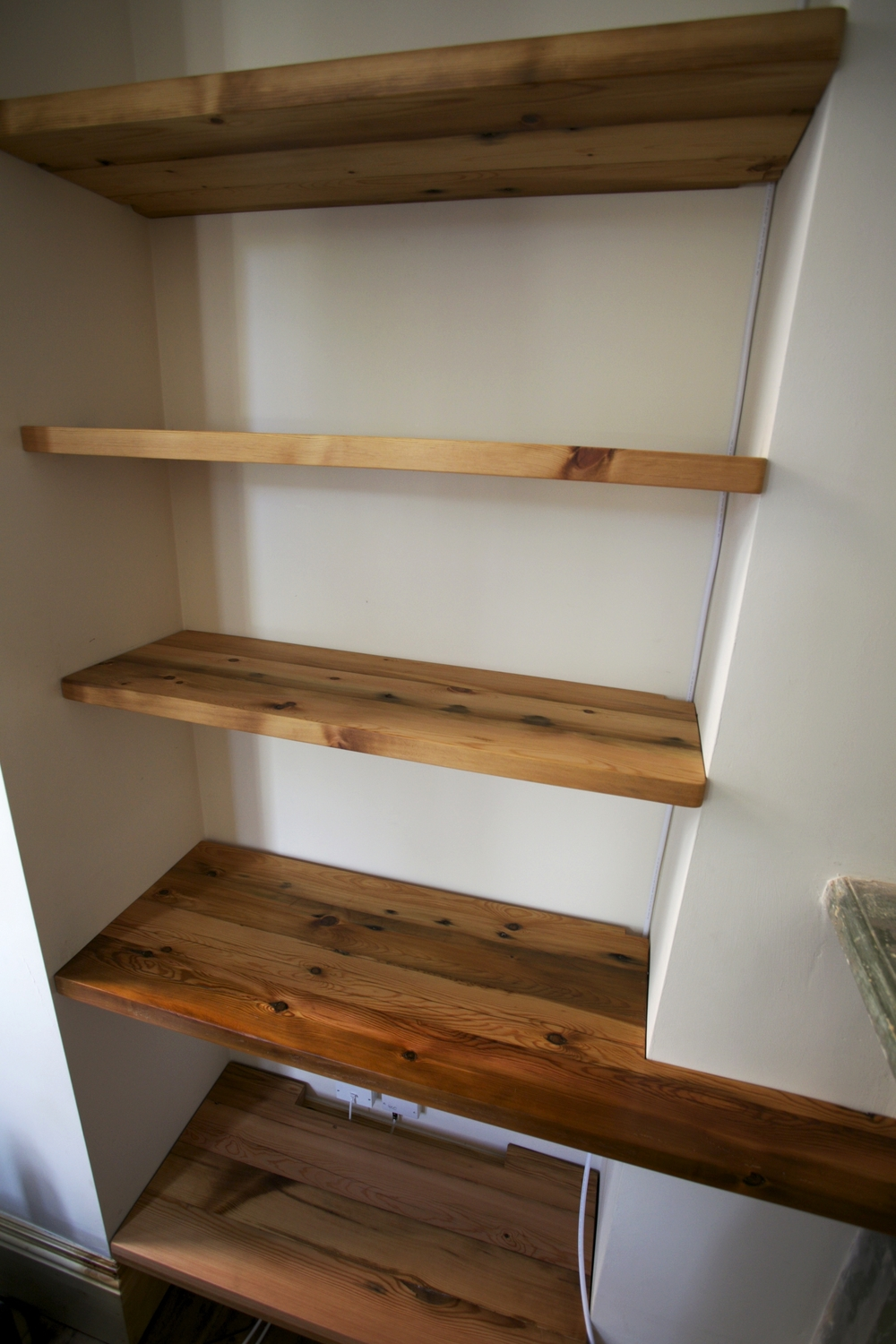 Old rafters made into bookshelves