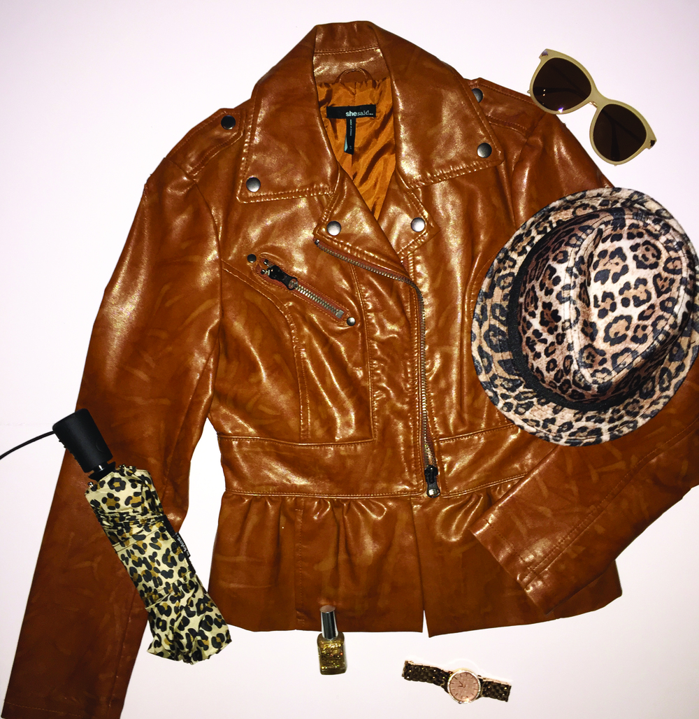 Retro Inspired faux leather jacket. Mix and match faux Cheetah prints with vintage inspired sun glasses.  Get it girl!