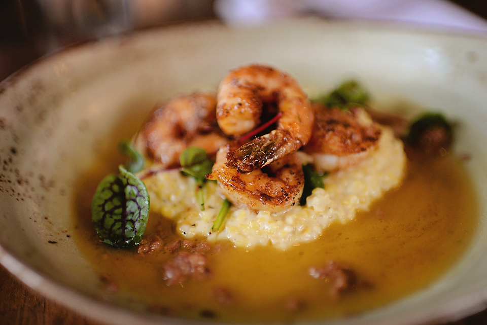 Shrimp and GritsTiger shrimp, stone ground goat cheese gritsand Andouille broth -