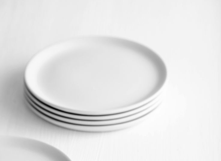 Set of plastic plates –  designed with illustrations holding information, quotes, facts and thought starters about gender equality.