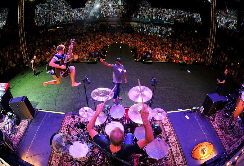 Mark Bryan (mid-air) with Hootie & the Blowfish