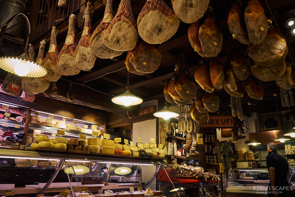 Prosciutto, or Italian Ham, hanging from the ceiling.